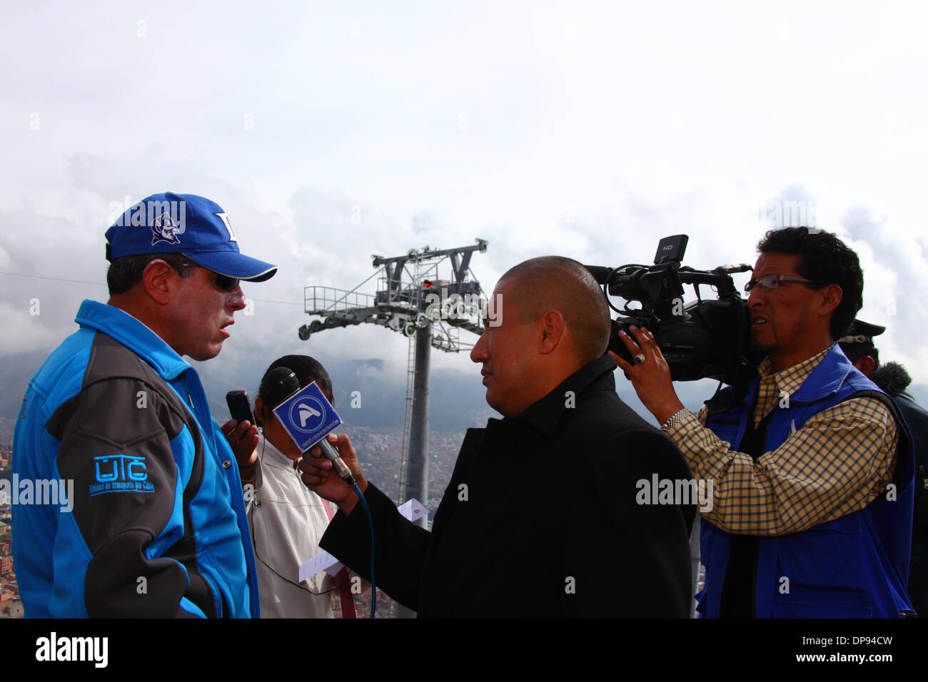 EL ALTO, BOLIVIA, 9th January 2014. The Unidad de Transporte por Cable (UTC) Project Coordinator César Dockweiler speaks to the press during construction of the new cable car / gondola lift system to link the city to La Paz below. Credit:  James Brunker / Alamy Live News - Stock Image