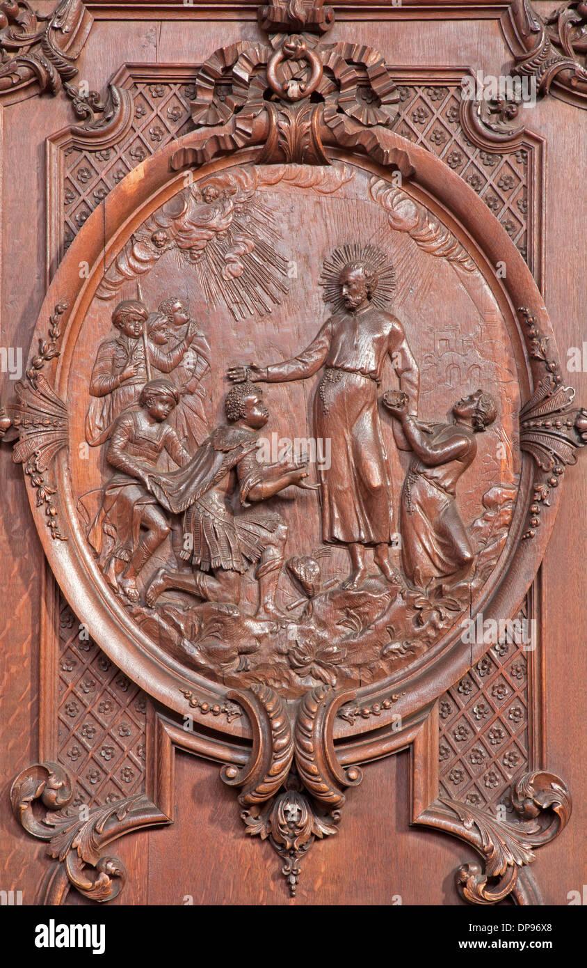 Antwerp - Carved scene as st. Francis Xavier baptist the king of Maledives St. Charles Borromeo church - Stock Image