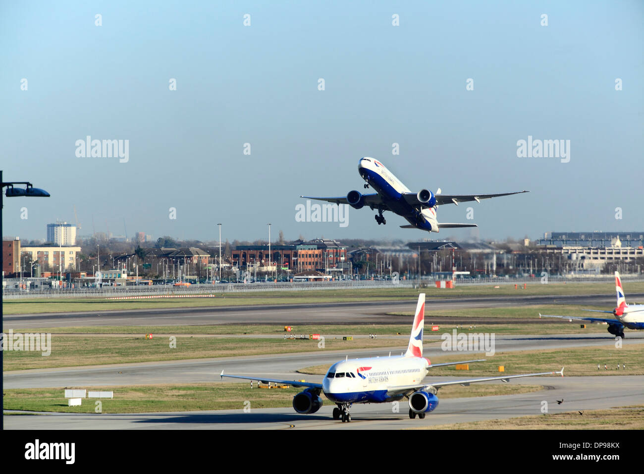 British Airways Boeing 767 takes off at Heathrow Airport runway 27R - Stock Image