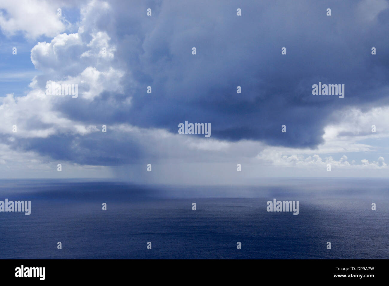Rain squall over the Pacific Ocean off of Easter Island, Chile - Stock Image