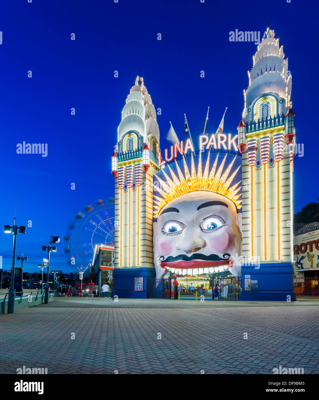 Luna Park Amusement park at night, Sydney, Australia - Stock Image