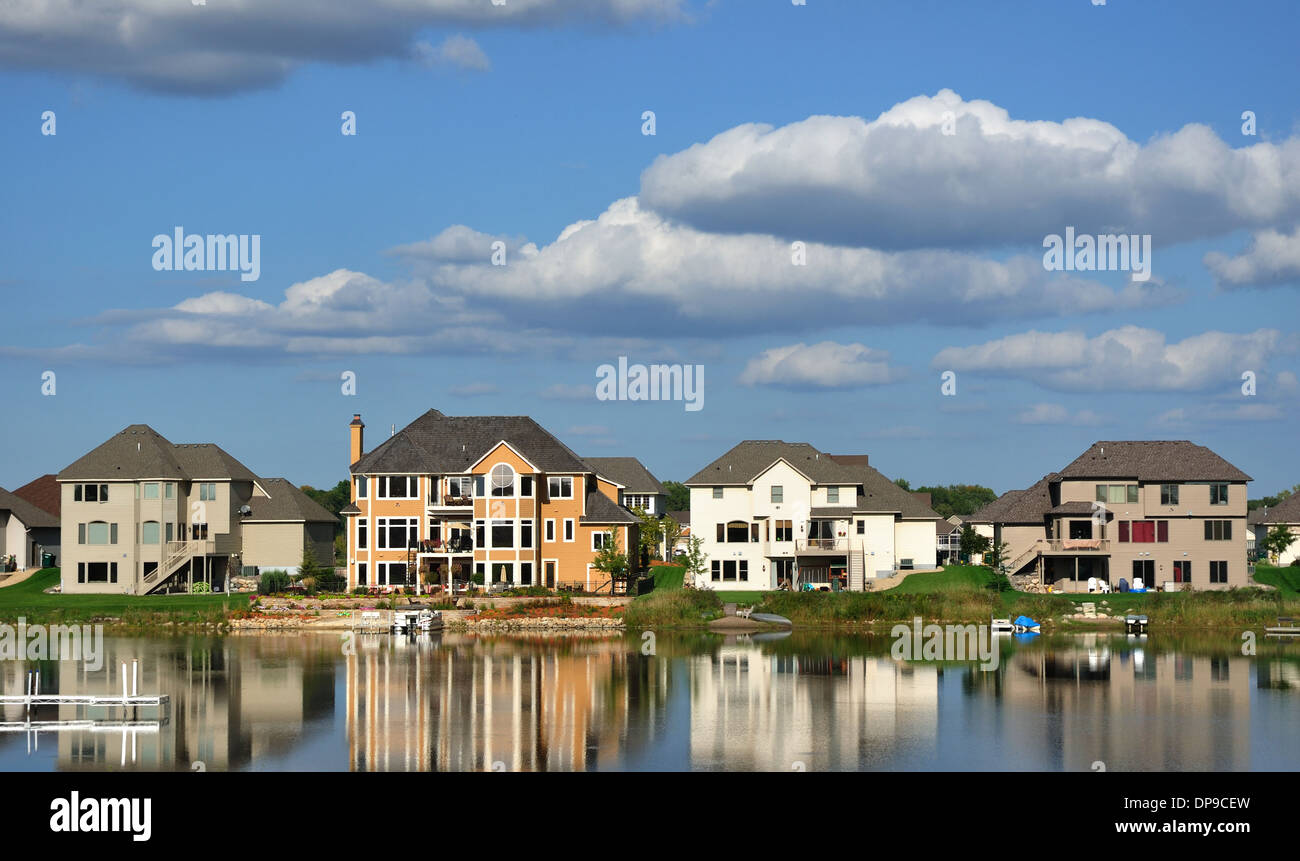 Luxury houses USA - American residential executive house homes on a suburban lake complex - Stock Image