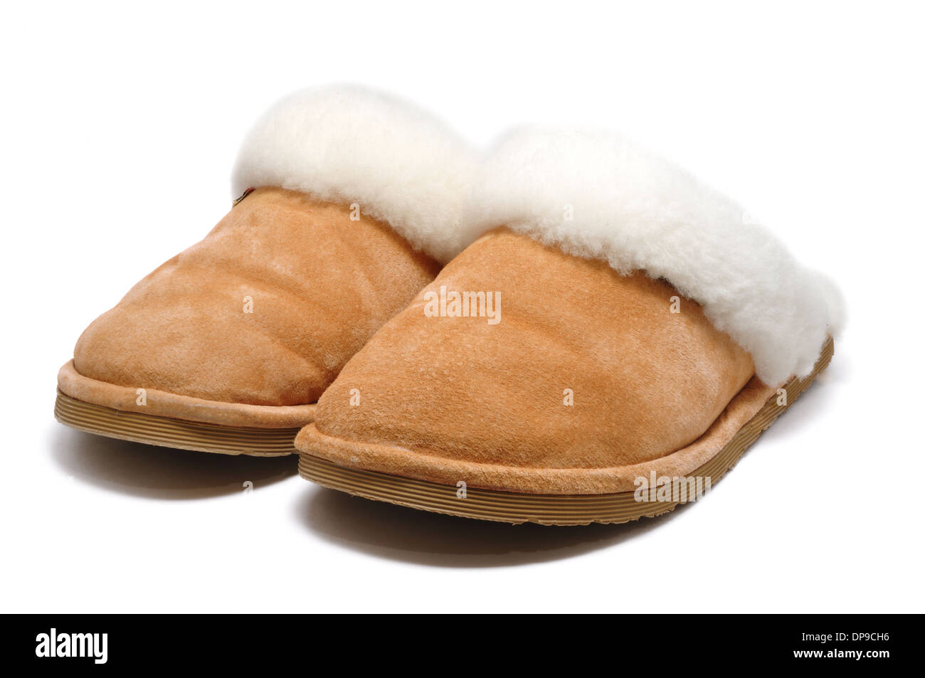 Pair of comfy, fluffy leather slippers - Stock Image
