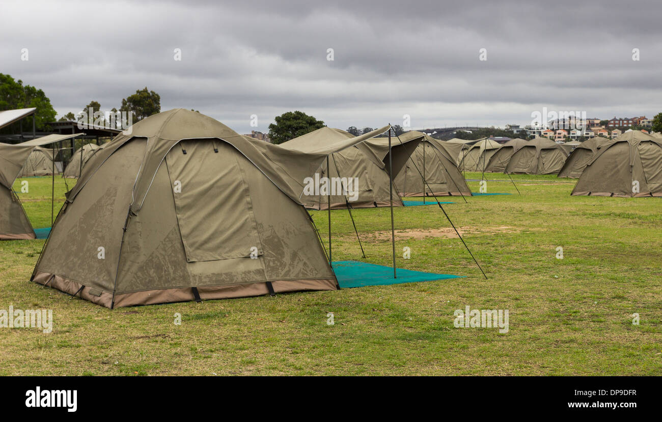 Rows of tents on a campsite on a wet day - Stock Image