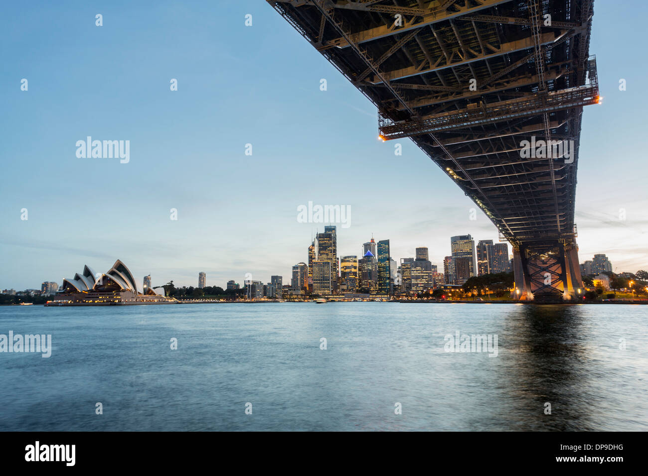 Under the Sydney Harbour Bridge at sunset, Sydney, Australia - Stock Image