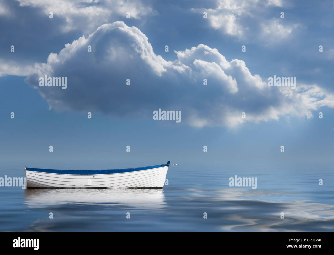 Loneliness, lack of leadership, lost, no direction, drifting conceptual image of empty rowing boat at sea - Stock Image