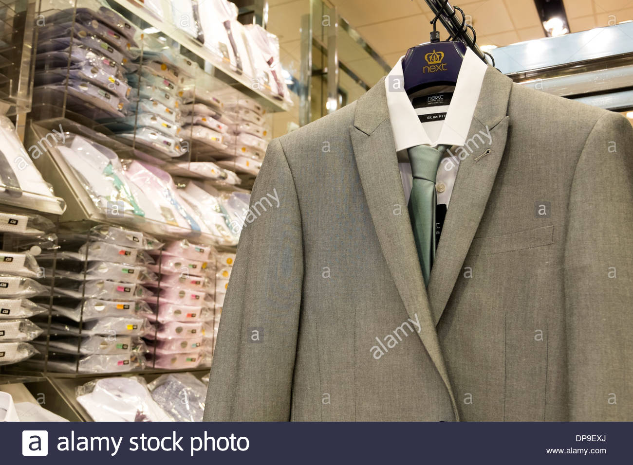 Suits for sale in Next store at Merry Hill, UK. - Stock Image