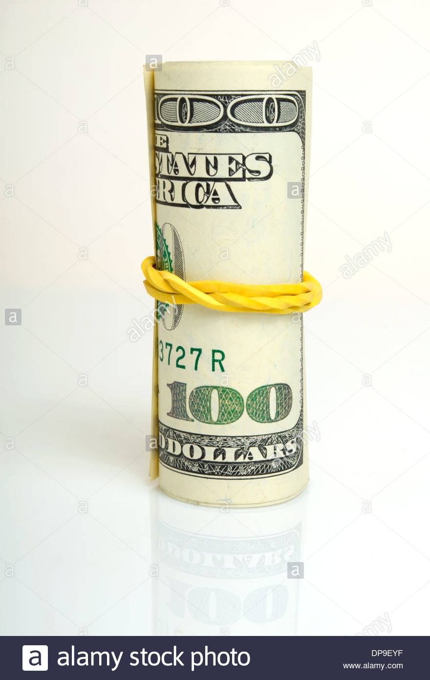Roll of dollars close-up on a light. - Stock Image