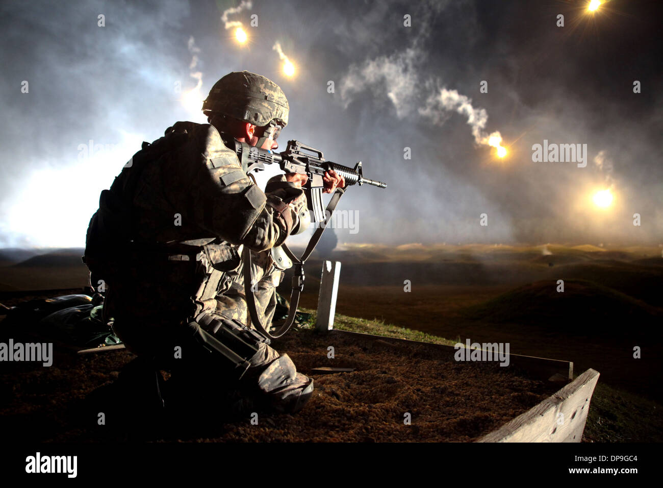 U.S. soldier watches his firing lane for targets during the Army's 10th annual Best Warrior Competition - Stock Image