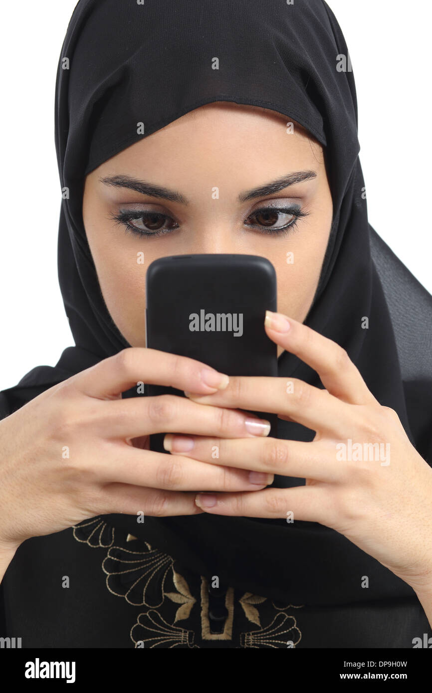 Front view of an arab woman addicted to the smart phone isolated on a white background - Stock Image