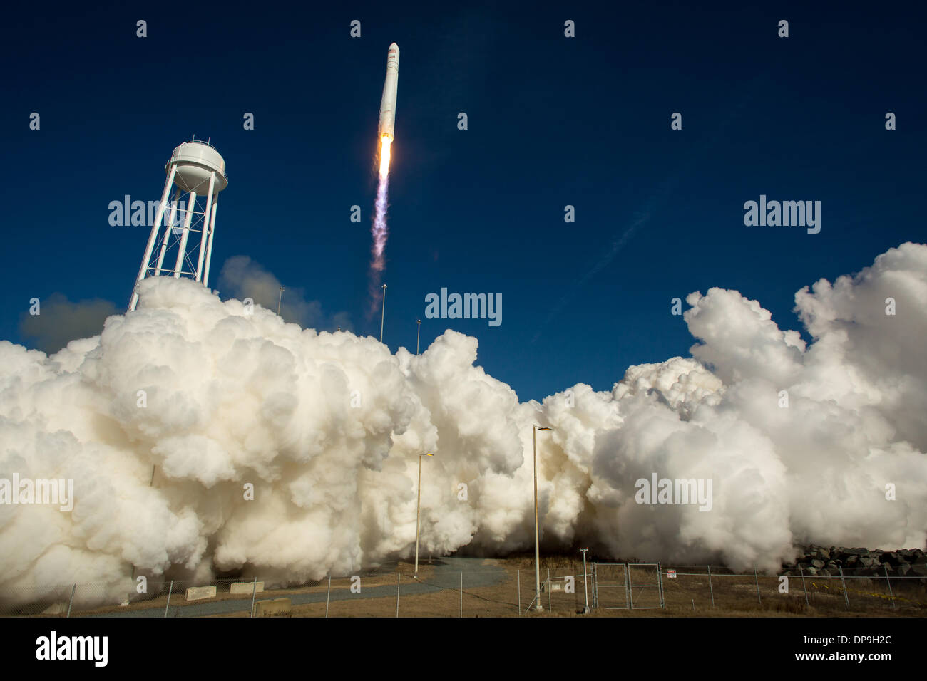 An Orbital Sciences Corporation Antares rocket launches from Pad-0A at NASA's Wallops Flight Facility January 9, 2014 in Wallops Island, VA. Antares is carrying the Cygnus spacecraft on a cargo resupply mission to the International Space Station. - Stock Image