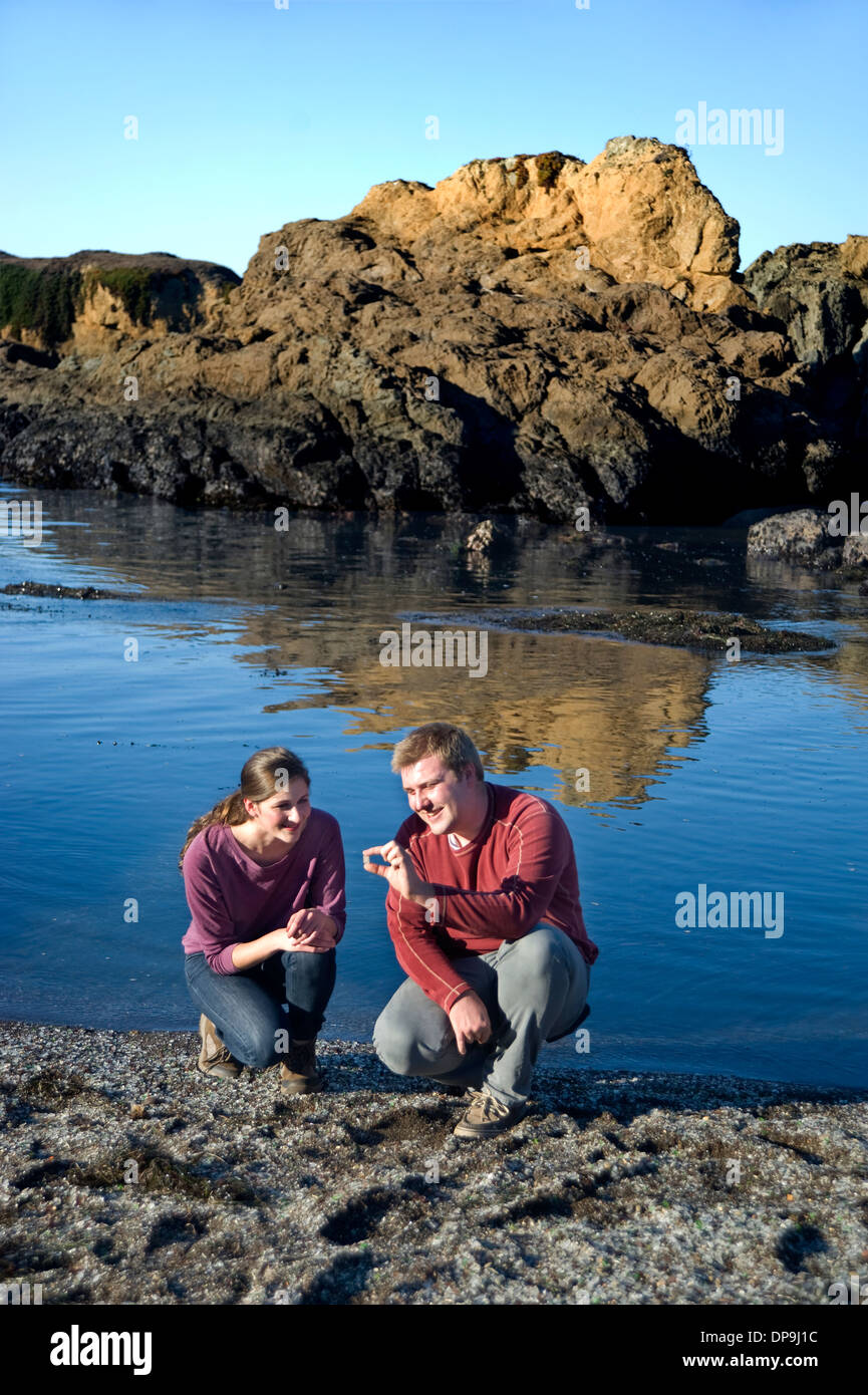 Couple exploring Glass Beach in Fort Bragg, California - Stock Image