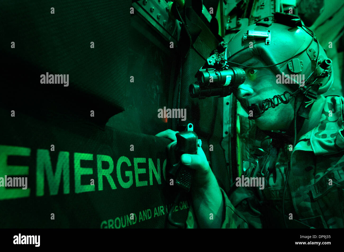 U.S. Air Force Airman uses night vision goggles to scan for potential threats in Afghanistan - Stock Image