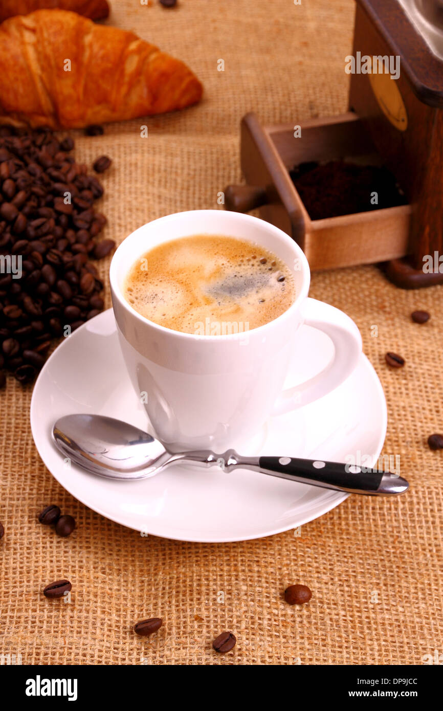 Coffee in white cup and croissant, vertical - Stock Image