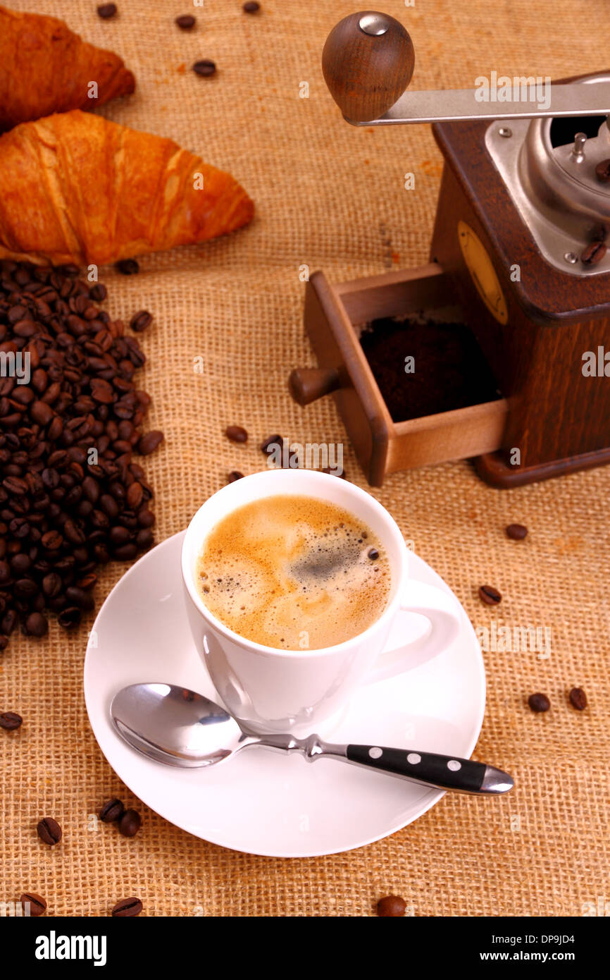 Coffee in white cup and coffee mill, vertical - Stock Image