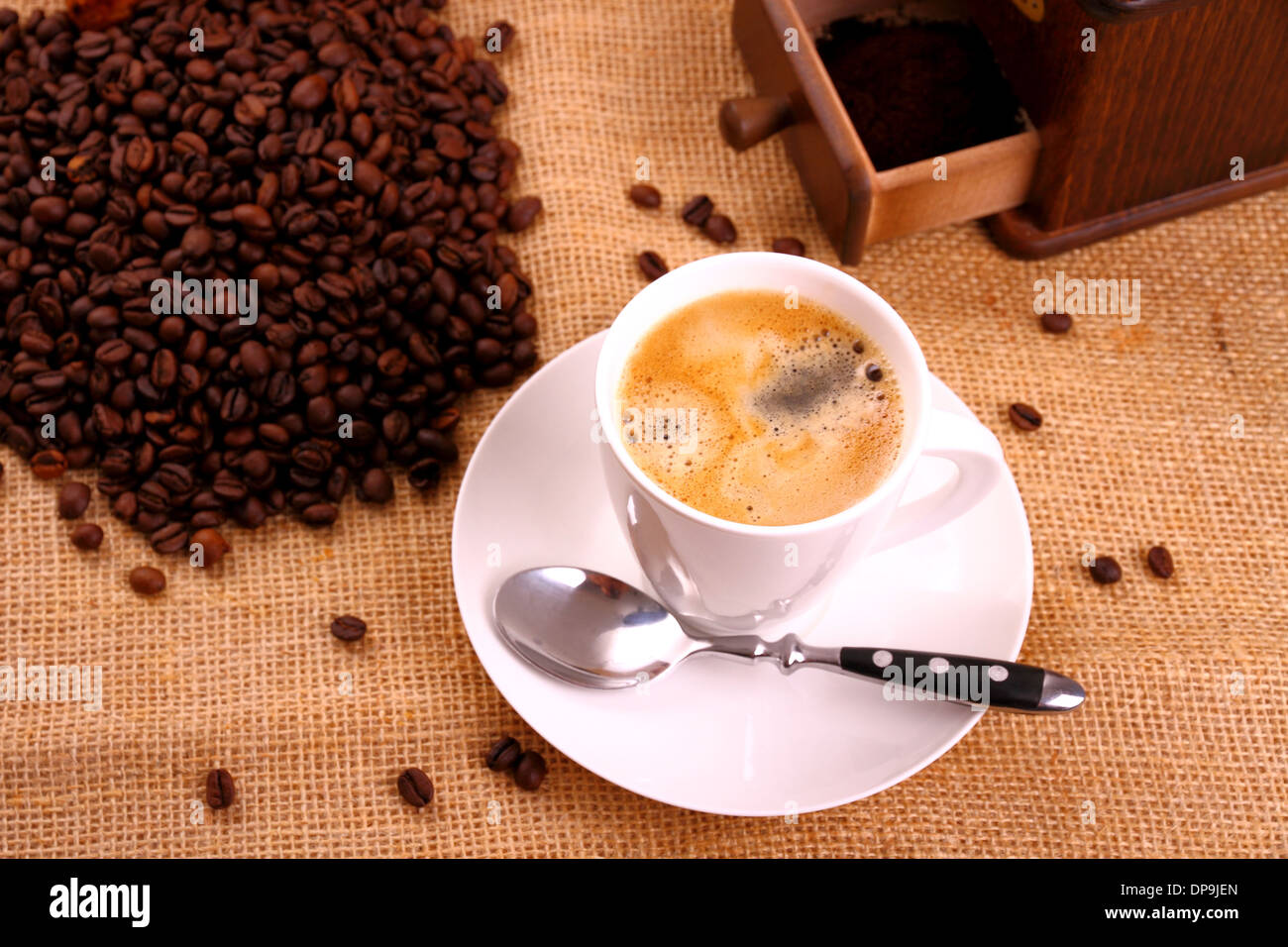 Coffee in white cup and coffee mill, horizontal - Stock Image