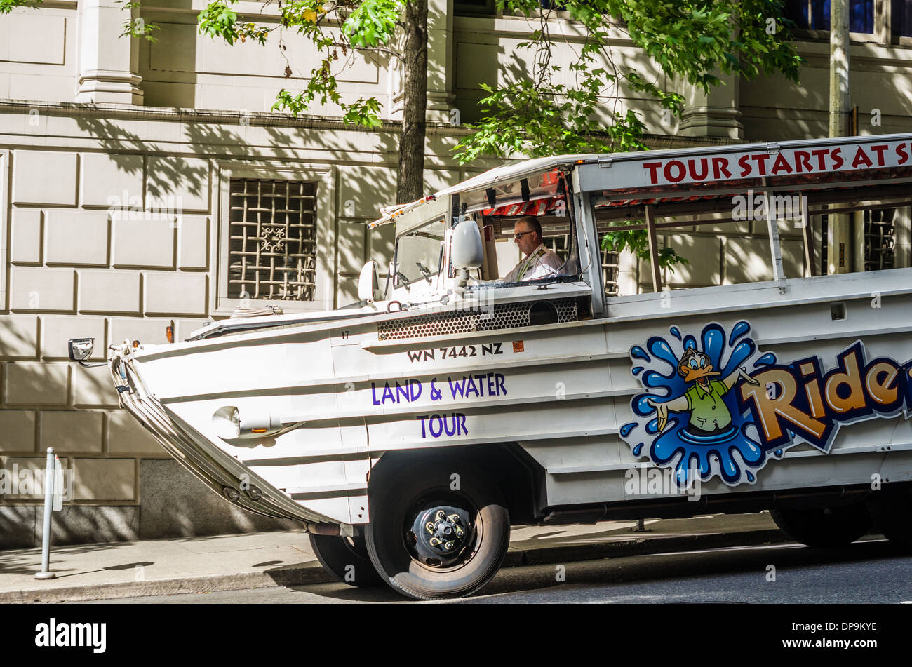 Duck tour vehicle with driver waiting to pick up tourists. Seattle, Washington - Stock Image