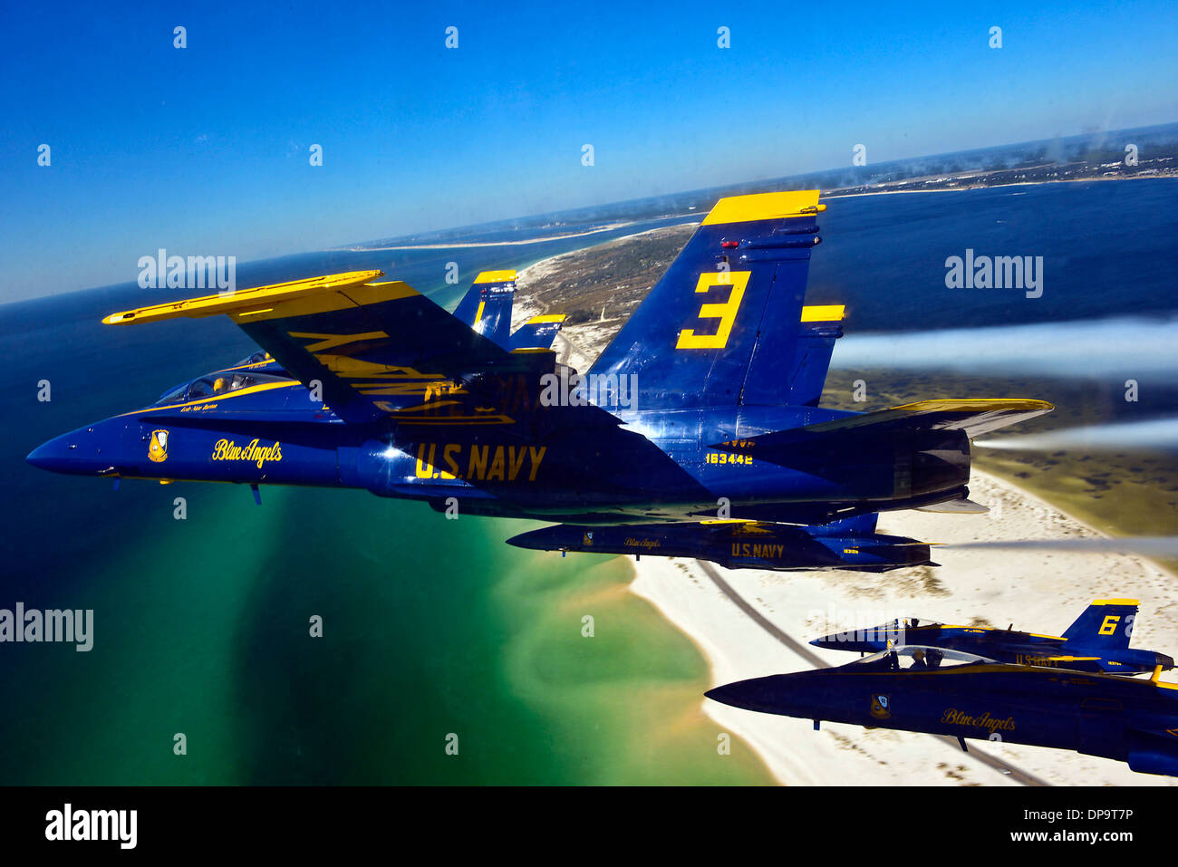 Pilots of the U.S. Navy Blue Angels fly in a delta formation during a training flight - Stock Image