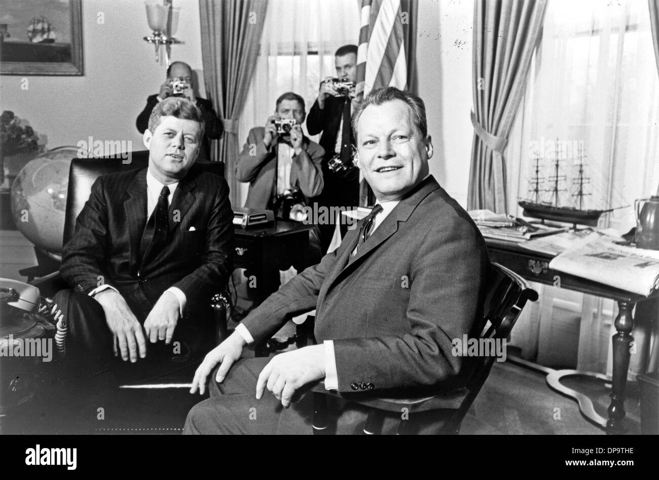 John F. Kennedy meeting with German statesman and politician Willy Brandt at the White House. - Stock Image
