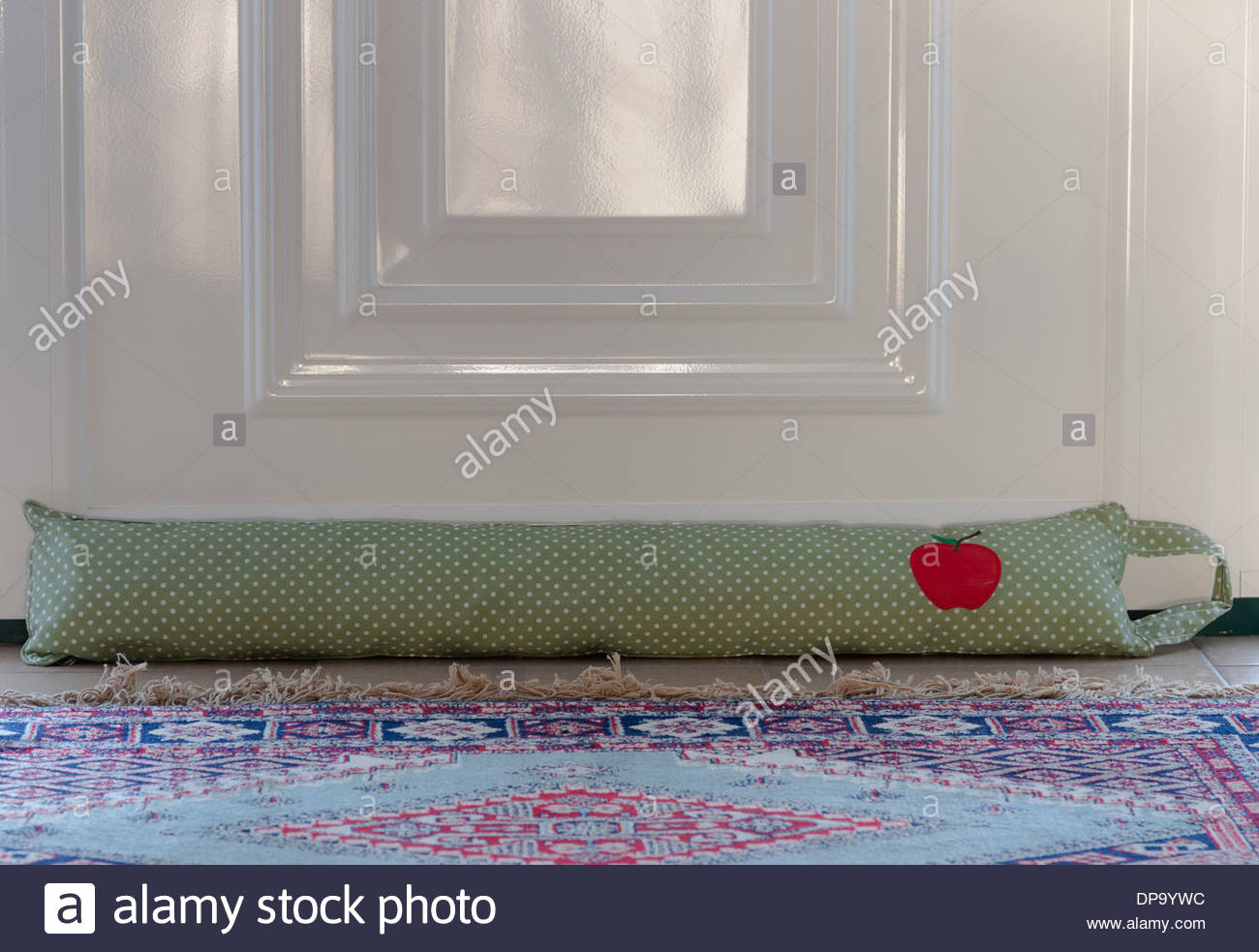 draught excluder against a door - Stock Image