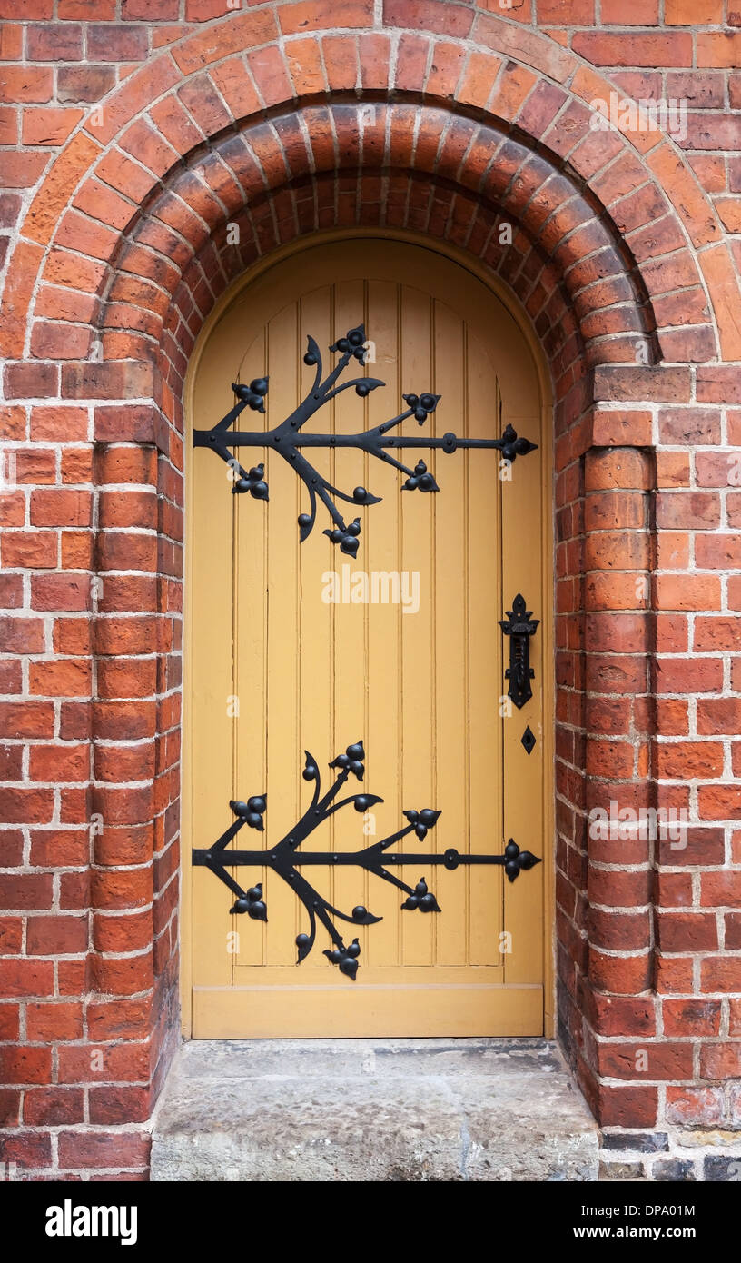 Gothic door in red brick wall of old Cathedral, Riga, Latvia Stock ...