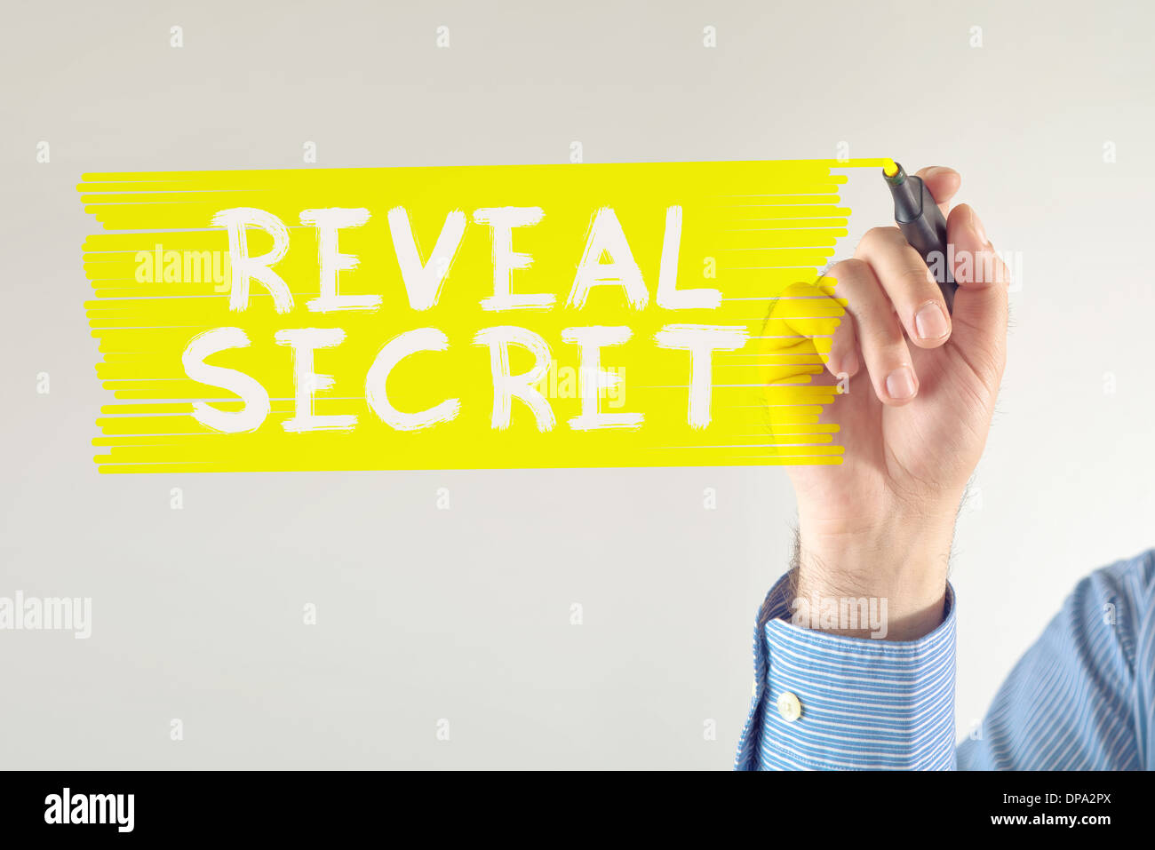 Revealing business secrets, businessman writing note with marker pen. - Stock Image