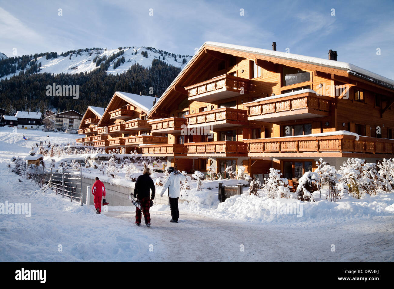 Skiers returning to their ski chalet, Swiss skiing village of Morgins, Switzerland Europe - Stock Image