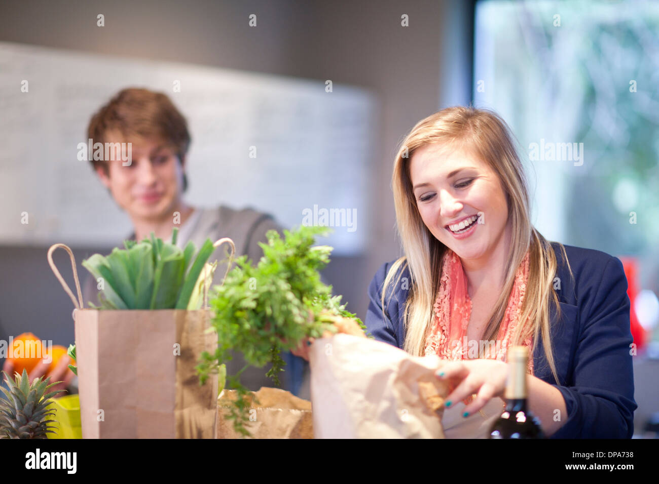 Young couple unpacking groceries - Stock Image