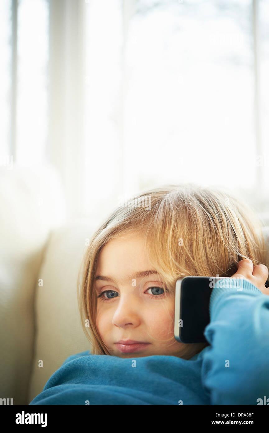 Girl making phonecall using smartphone - Stock Image