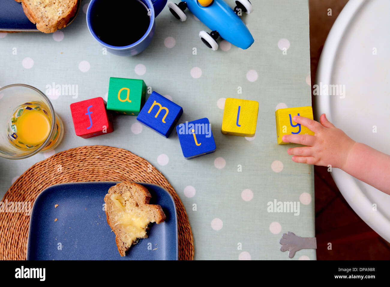 Baby spelling with alphabet blocks - Stock Image