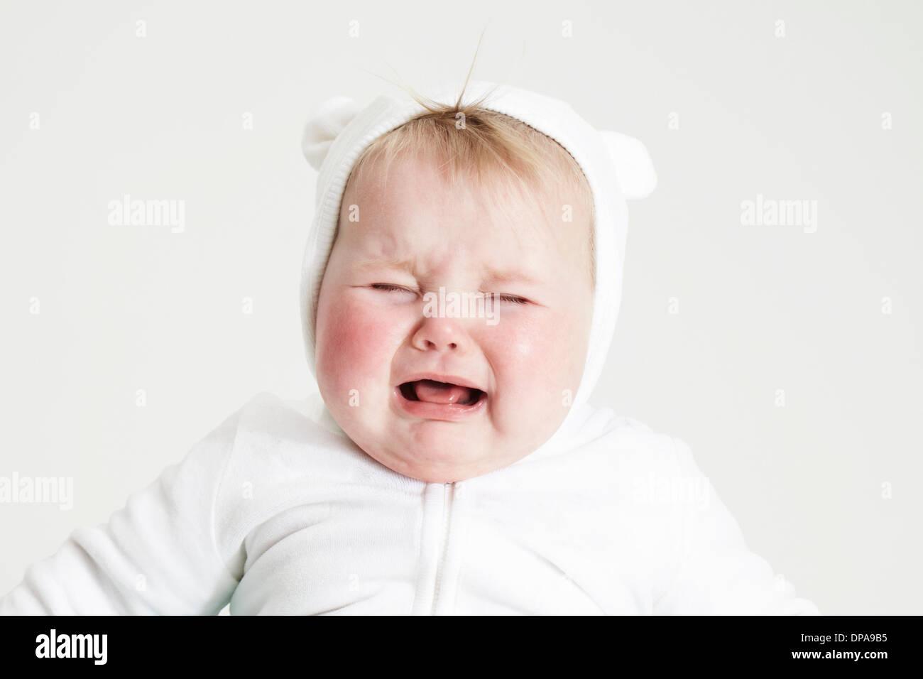 Baby girl crying - Stock Image