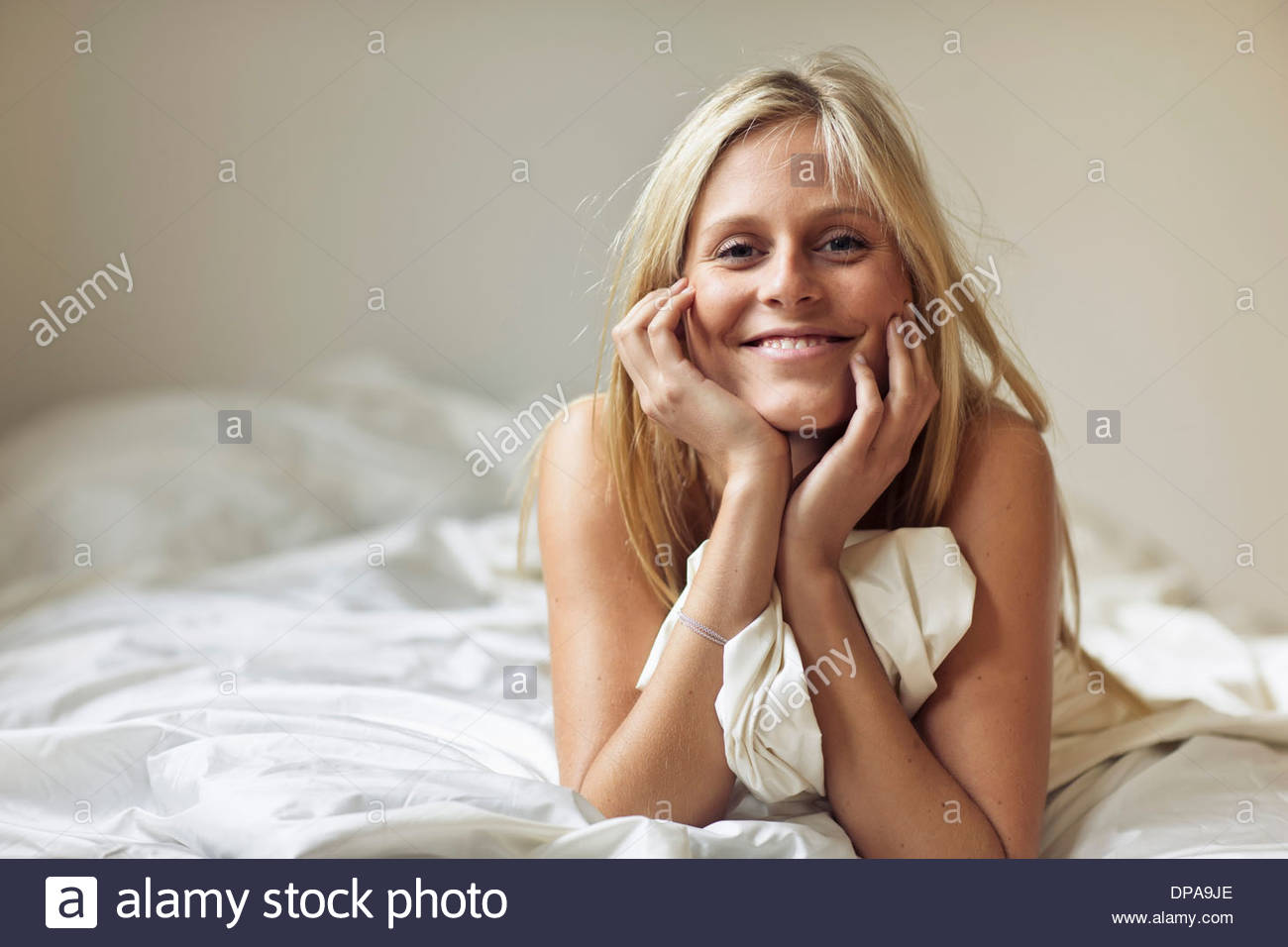 Woman lying on stomach - Stock Image