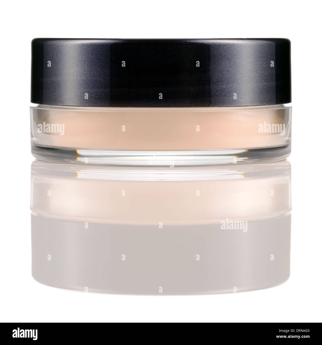 Translucent loose powder in a jar isolated on white background. Make-up product with silk. Stock Photo