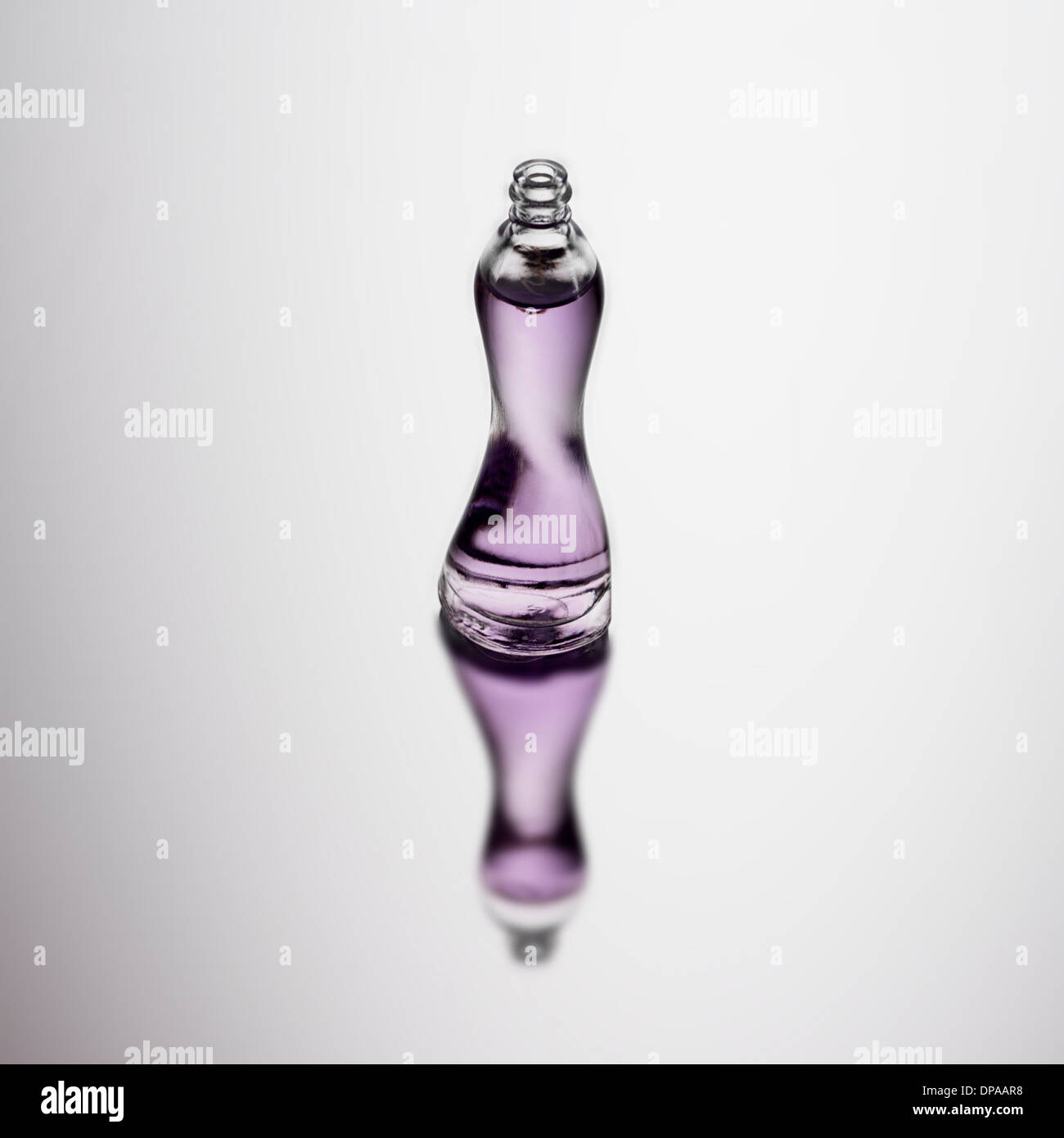 Bottle of perfume with reflection - Stock Image