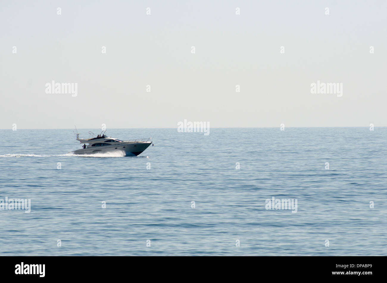 A small cruiser boat in the mediteranean sea - Stock Image