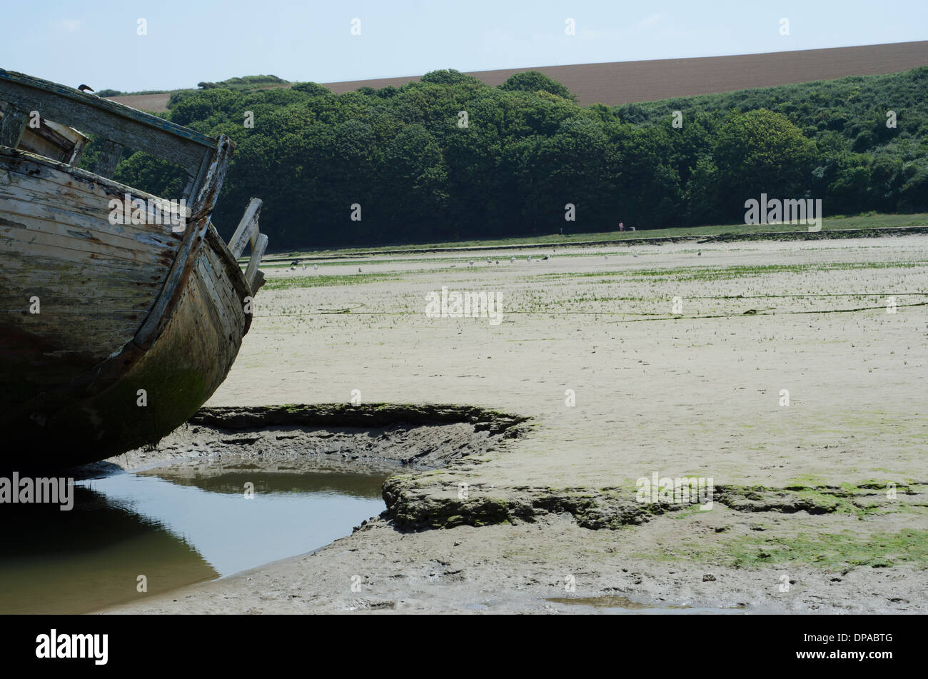 An old boat wreck in the sand in Newquay Stock Photo