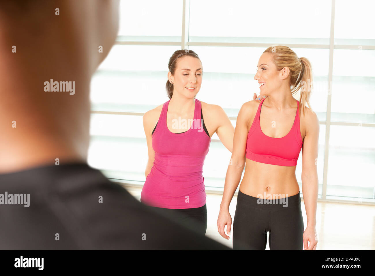Women standing together in exercise class - Stock Image