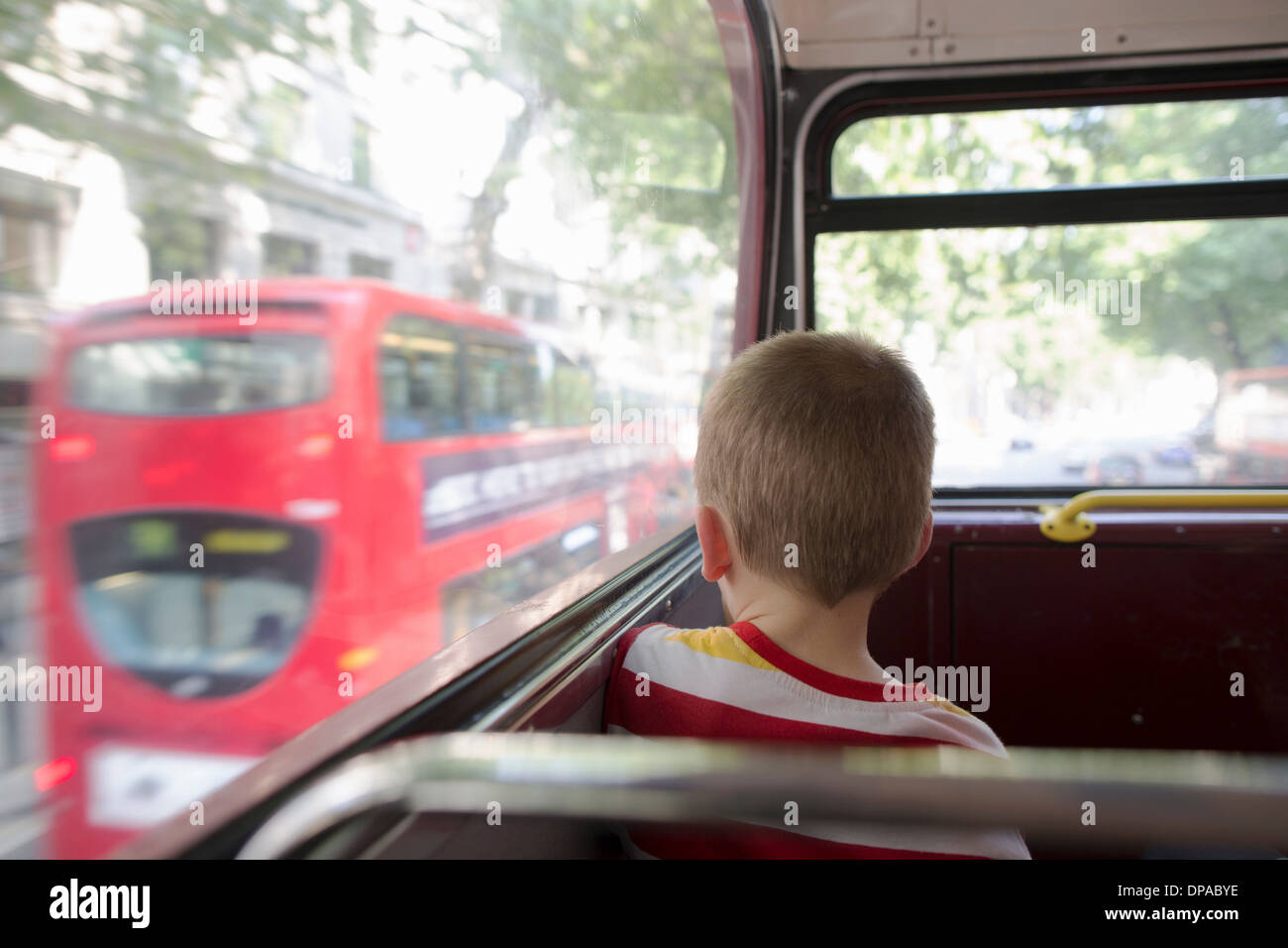 Young boy on double decker bus in London - Stock Image