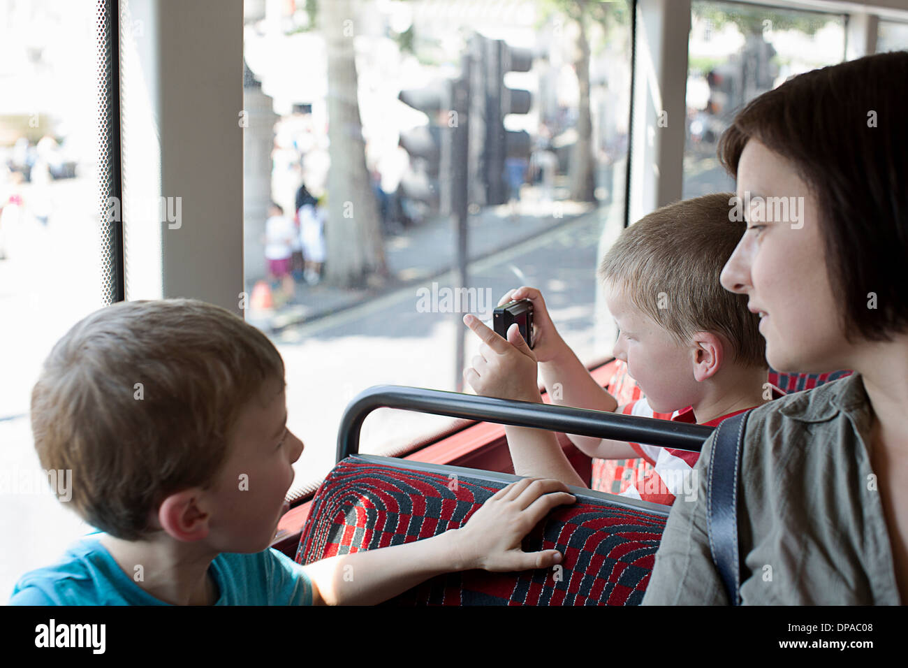 Mother and sons on double decker bus in London - Stock Image