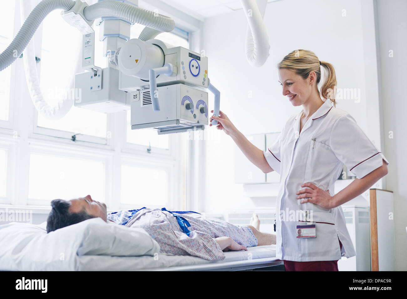 Radiologist scanning patient - Stock Image
