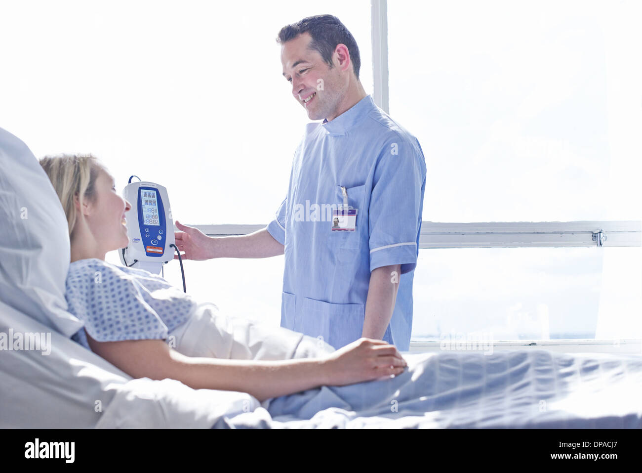 Nurse taking patient's blood pressure - Stock Image