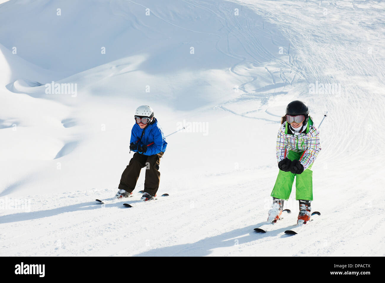 Brother and sister skiing, Les Arcs, Haute-Savoie, France Stock Photo