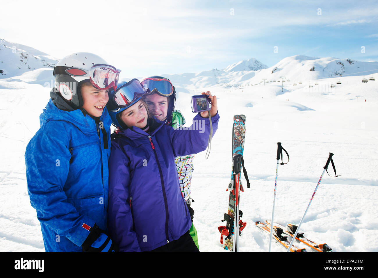 Brother and sisters taking self portrait, Les Arcs, Haute-Savoie, France - Stock Image