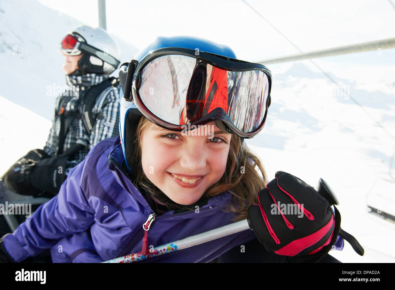 Portrait of young girl on ski lift, Les Arcs, Haute-Savoie, France - Stock Image