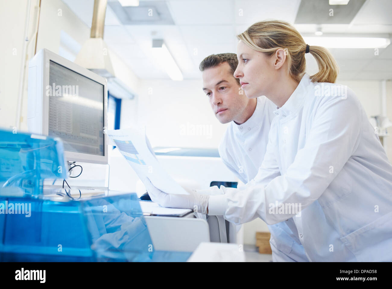 Researcher using computer - Stock Image