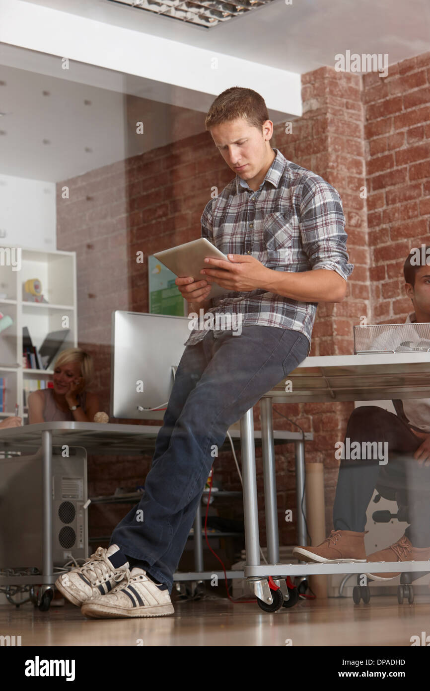 Young man using digital tablet in modern office Stock Photo