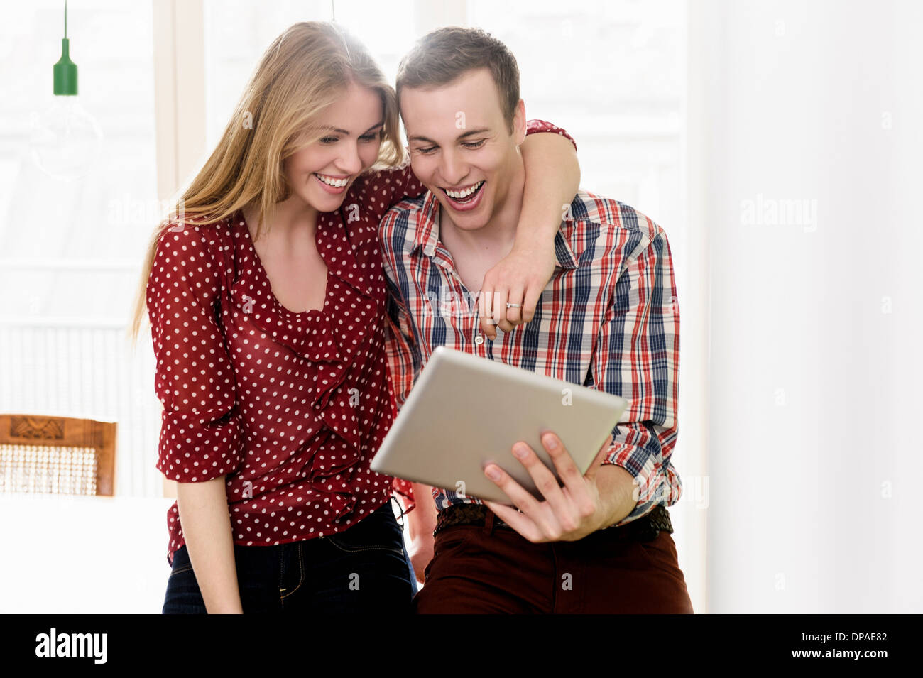 Couple on video chat using digital tablet - Stock Image