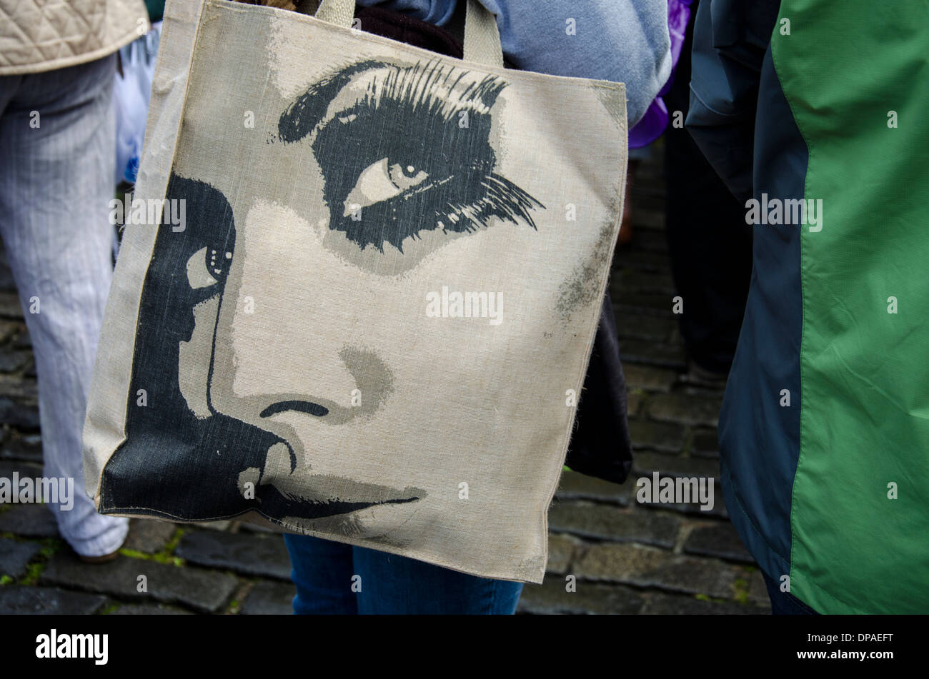 Drawing of a young woman's face on a reusable shopping bag. - Stock Image