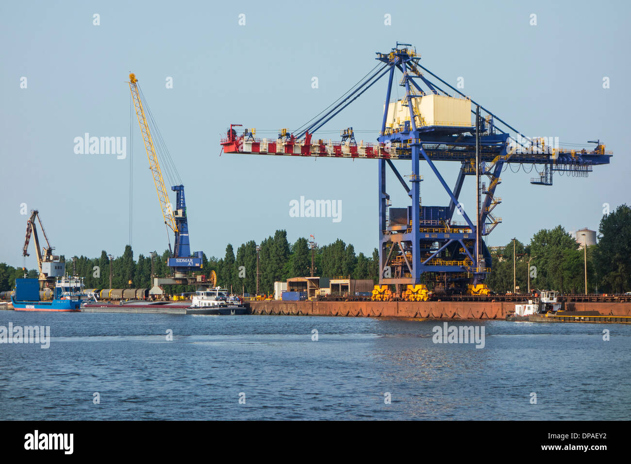 Dock cranes at the steelworks of ArcelorMittal Gent, world's largest steel producer, port of Ghent, East Flanders, Stock Photo
