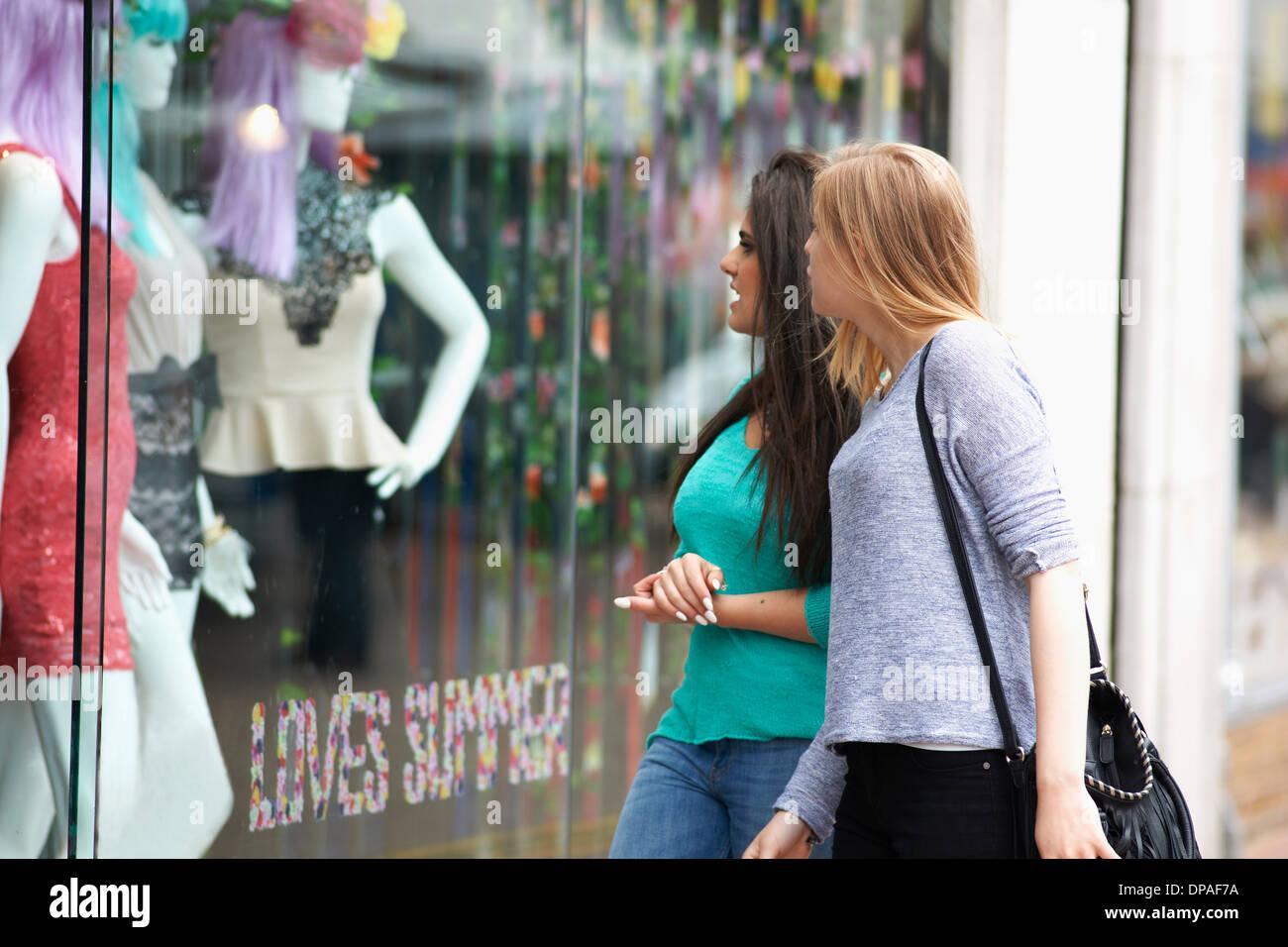 Two teenage girls window shopping - Stock Image